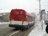 Prototype bus #7800 at California and Archer, on its way to Archer Garage, on January 22, 2005.