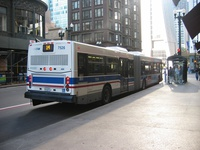 Bus #7526 at Madison and State, working route #14 Jeffery Express, on September  5, 2003.