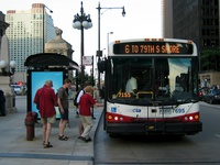 Bus #7695 at Wacker and Michigan, working route #6 Jackson Park Express, on June 10, 2005.