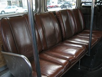 The 7300-series featured brown leather seats, uncommon for CTA buses, as seen in this April 13, 2004 photograph.