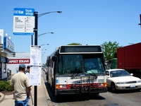 Bus #5531 at Kedzie and Archer, working route #52 Kedzie/California, on June  8, 2006. Starting June 18, 2006 service on the #52 was extended to 63rd St. during all times of service. An updated bus stop sign, along with service alerts detailing both the #52 and #52A route changes can be seen.