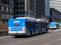 Bus #4097 at Michigan and Madison, working route #J14 Jeffery Jump, on January 16, 2013. In the distance is bus #4085.