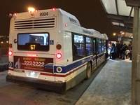 Bus #8004 at 69th Red Line Station, working route #67 67th/69th/71st, on February 20, 2015.