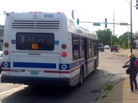 Bus #8103 at Grand and Cicero (Metra Station), working route #65 Grand, on July 28, 2015.