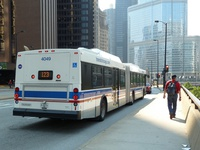 Bus #4049 at Wacker and Stetson, working route #123 Illinois Center/Union Express, on May 25, 2010.