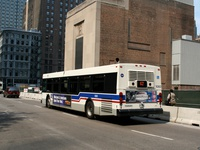Bus #1060 at Dearborn between Washington and Randolph, working route #62 Archer, on June 16, 2006.